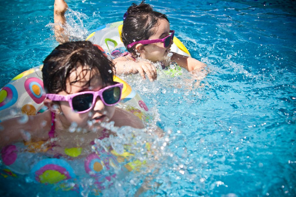 Kids enjoying the pool because of solar pool heating
